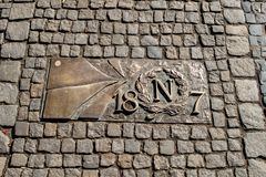 Wroclaw, Poland - March 9, 2018: One of the metal plaques on Wroclaw`s Sidewalk Timeline commemorating influential dates. Wroclaw, Poland - March 9, 2018: View royalty free stock photo