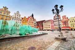 Wroclaw, Poland. The market square with the famous fountain. And colorful historical buildings. Silesia region Royalty Free Stock Image