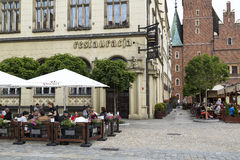 Wroclaw, Poland, 23 May 2015: People eating lunch at a street restaurant in old town of Wroclaw, Poland Stock Photos