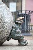 Wroclaw Sisyphus gnome. WROCLAW, POLAND - MAY 11, 2018: Sisyphus gnomes of dwarves small statues in Wroclaw, Poland. Wroclaw has 350 gnome sculptures around the royalty free stock image