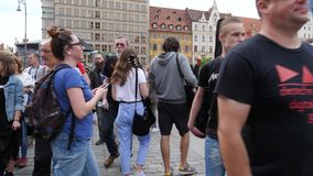 Urban bustle, many passers by walk along street in town square. Wroclaw, Poland 12 May 2018: urban bustle, many passers by walk along street in town square in stock video
