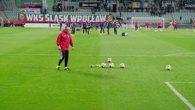 Soccer players of Slask Wroclaw team are warm up on the stadium field before the game in Polish football League