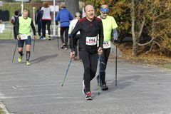 WROCLAW, POLAND - OCTOBER 15, 2017: People in fitness course nordic walking competition in the city park Stock Photos