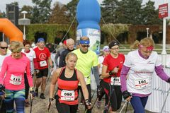 WROCLAW, POLAND - OCTOBER 15, 2017: People in fitness course nordic walking competition in the city park Stock Image