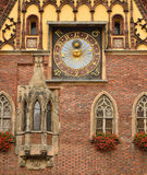 Wroclaw, Poland. Old clock on the facade of the town hall on the main squer in Wroclaw, Poland Stock Image