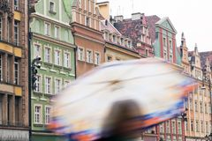 Wroclaw, Poland. A person with umbrella on the rainy market square Stock Photography