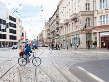 Bicyclist on the tramway in Wroclaw city Royalty Free Stock Photos