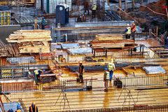 Wroclaw, Poland - September 10, 2017: Construction site workers, construction crews working. On high ground heavy industry and safety concept Royalty Free Stock Image