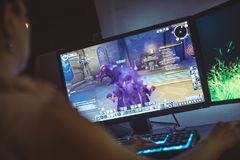 Woman playing World of Warcraft: Battle for Azeroth game. WROCLAW, POLAND - SEPTEMBER 04th, 2018: WoW is a massively multiplayer online role-playing game MMORPG royalty free stock images