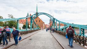 Tourists on Tumski Bridge in Wroclaw city Royalty Free Stock Image