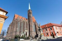 Wroclaw, Pologne - vers en mars 2012 : Église collégiale de la croix et de St Bartholomew saints à l'île d'Ostrow Tumski à Wrocla Photos stock