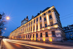 Wroclaw university with vehicular light trails, in the evening. Royalty Free Stock Photography