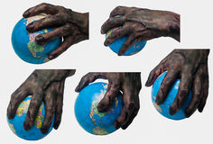 Wrold in Zombie hand. (Festival of Halloween is the world of demon Royalty Free Stock Image
