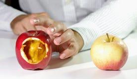 Wrong choice. Represented by a hollow apple chosen Stock Photos