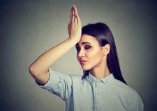 Wrong doing. Closeup portrait upset woman, slapping hand on head having duh moment Royalty Free Stock Image