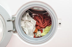Wrong loaded washing machine Stock Photo