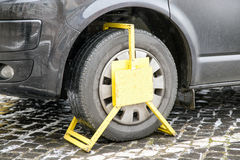 Wrong parked vehicle with yellow wheel clamp Stock Photos