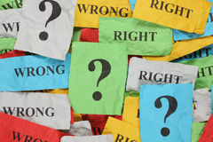 Wrong or Right?. Crumpled colorful paper notes with words Wrong, Right and question marks Royalty Free Stock Images