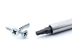 Wrong screwdriver. Two screws with a screwdriver that does not fit Royalty Free Stock Image