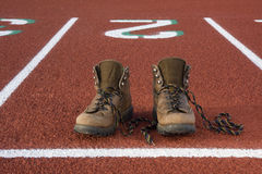 Wrong shoes on running tracks Royalty Free Stock Photo