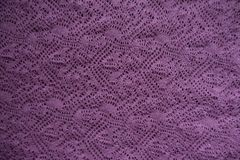 Wrong side of pink knitted lace. From above stock images
