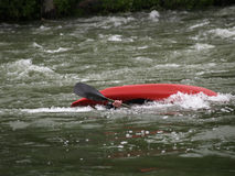 Wrong Side Up. This picture was taken at the Bigfork Whitewater Festival in western MT and shows a kayaker upside down and about to right himself Stock Photo