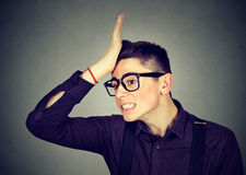 Wrong. Silly man slapping hand on head having duh moment Royalty Free Stock Image