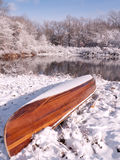 Wrong Time of Year. A woodstrip canoe that is placed in the wrong time of year for boating royalty free stock image