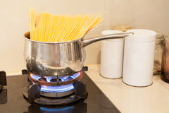Wrong to Boiling spaghetti in a stainless steel pot Stock Photography