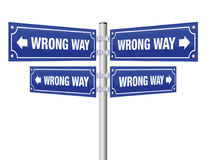 Wrong Way Guidepost. Showing in four different directions that lead always to an incorrect destination - symbolic for misconduct, pessimism, wrongdoing, misstep Stock Photos