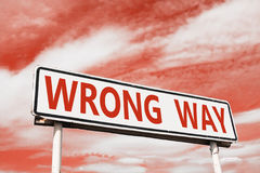 Wrong way road sign Stock Photo