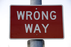 Wrong way sign Stock Images