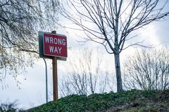 Wrong way sign on the hill royalty free stock images