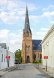 Wrong Way to Church. Wrong way road signs on one way street leading to historic church steeple.  Ironic good vs evil symbolism Stock Photos