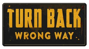 Wrong Way Wrong Track Turn Back Sign Grunge. Retro business advice metal tin antique saying street road closed caution royalty free stock image