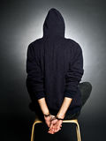 Wrongdoer. A man with handcuffs - wrongdoer on black background Stock Image