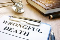 Wrongful death form on a table. Wrongful death form and stethoscope on a table stock photos