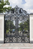 Wrought gates. Image of a decorative cast iron gates. metal gates close up. beautiful gates with artistic forging.Image of god and Royalty Free Stock Photo