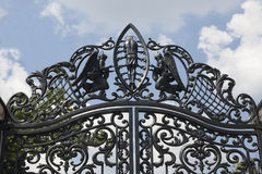 Wrought gates. Image of a decorative cast iron gates. metal gates close up. beautiful gates with artistic forging.Image of god and Royalty Free Stock Photos