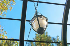Wrought iron arbor with lantern. And blue sky Royalty Free Stock Photo
