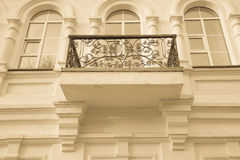 Wrought-iron balcon on the light side of the building. Toned Royalty Free Stock Image
