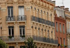 Wrought iron balconies of houses Royalty Free Stock Image