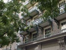Wrought iron balconies on a large spartment block. Wrought iron balconies on a large apartment brick building in Manhattan New York Stock Photography