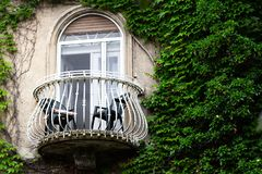 Wrought iron balcony of old building stock image