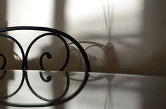 Wrought iron chair. Wrought iron dining table set with glass top and chair Royalty Free Stock Images