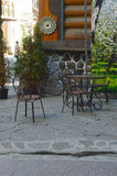Wrought iron chairs in the courtyard in front of the restaurant Royalty Free Stock Photo