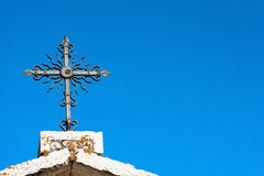 Wrought Iron Cross on Blue Sky Royalty Free Stock Photo