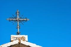 Wrought Iron Cross on Blue Sky Royalty Free Stock Photo