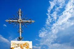 Wrought Iron Cross on Blue Sky Stock Photo