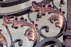 Wrought iron. Details of structure and ornaments of wrought iron fence and gate Stock Photos